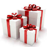 Gift boxes. With red bows Royalty Free Stock Photography