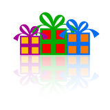 Gift Boxes. 3 Gift boxes with bright colors on a white background with reflections Royalty Free Stock Photography