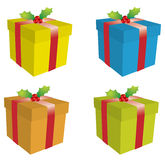 Gift boxes. Four different colour gift boxes, holly berries with ribbons royalty free illustration