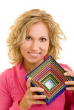 Gift boxes. Blonde woman holding colorful gift boxes royalty free stock image