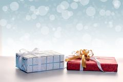 Gift boxes against bokeh background Stock Photography