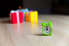 Gift boxes and alarm clock Stock Images
