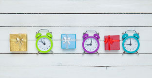 Gift boxes and alrm clocks Stock Photography