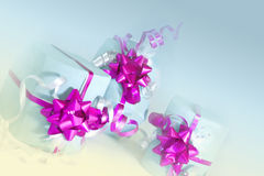 Gift boxes at an angle. Three decorated boxes on pastel background Royalty Free Stock Image