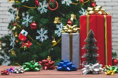 Gift boxes arange with colourful bows on wood board, Background royalty free stock images