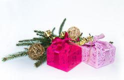 Gift boxes on the background of Christmas decorations royalty free stock photography