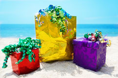 Gift boxes and bag on the beach - holiday concept Stock Photos