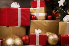 Gift boxes and balls under christmas tree Stock Photo
