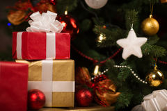 Gift boxes and balls under christmas tree Royalty Free Stock Photos