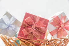 Gift boxes on basket isolated Stock Images