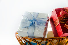 Gift boxes on basket isolated Royalty Free Stock Photos