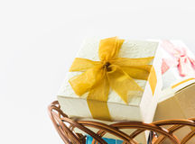 Gift boxes on basket isolated Stock Photography