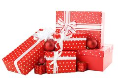 Gift boxes with baubles. Red gift boxes with baubles isolated on white Royalty Free Stock Photos