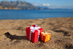 Gift boxes in a beach Stock Images