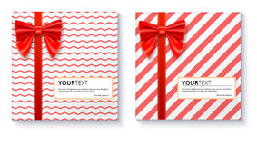 Gift boxes with big red bow and ribbon on white background. Royalty Free Stock Image