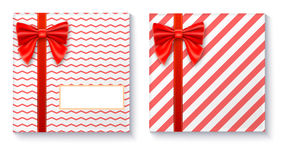 Gift boxes with big red bow and ribbon on white background. Stock Photo