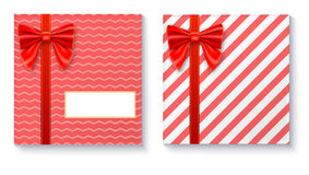 Gift boxes with big red bow and ribbon on white background. Stock Image
