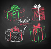 Gift boxes on black chalkboard background. royalty free illustration