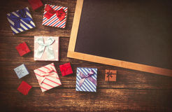 Gift boxes and blackboard Royalty Free Stock Photography