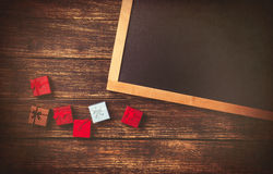 Gift boxes and blackboard Royalty Free Stock Image