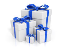 Gift boxes - Blue. White gift boxes in different sizes and blue ribbons - Image on white background with soft shadows and reflections Stock Photography