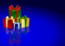 Gift boxes on blue background Royalty Free Stock Photography