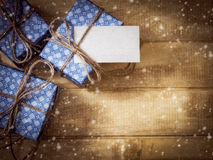 Gift boxes in blue paper on the wooden table Stock Photography