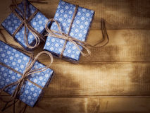 Gift boxes in blue paper on the wooden table Stock Images