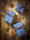Gift boxes in blue paper on the wooden table Royalty Free Stock Photography