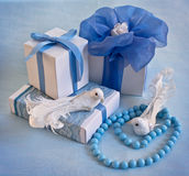 Gift boxes with blue ribbons Stock Images