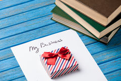 Gift boxes, books, pencil and paper royalty free stock photography