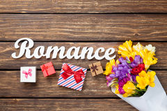 Gift boxes and bouquet of flowers with word Romance Royalty Free Stock Photography