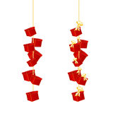 Gift boxes with bow hanging on a chain Stock Photos
