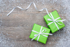 Gift boxes with bow and snowflakes Royalty Free Stock Images