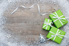 Gift boxes with bow and snowflakes. On wooden background Royalty Free Stock Images