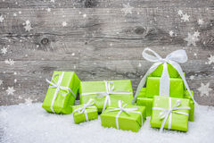 Gift boxes with bow and snowflakes. On wooden background Stock Images