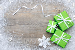 Gift boxes with bow and snowflakes Royalty Free Stock Image