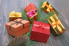 Gift boxes with bow on wood background Stock Images