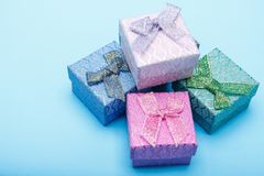 Gift boxes with bows on blue background.  Stock Photo