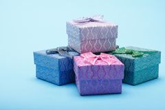 Gift boxes with bows on blue background Royalty Free Stock Photo