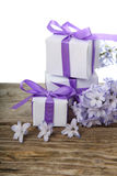 Gift boxes with bows and blue hyacinth Stock Image