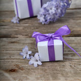 Gift boxes with bows and blue hyacinth Royalty Free Stock Photography