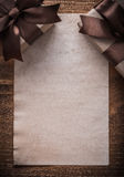Gift boxes with bows paper on vintage wooden board Stock Photography