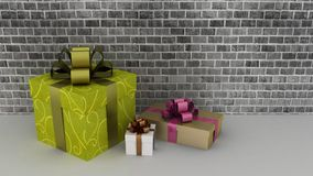 Gift boxes at a brick wall Royalty Free Stock Photos