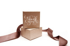 Gift boxes with brown ribbon on a white background  and text thank you Royalty Free Stock Images