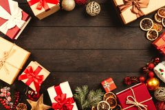Gift Boxes On Brown Wooden Board royalty free stock photo