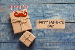 Gift boxes and card with words HAPPY FATHER`S DAY. On wooden background, top view Royalty Free Stock Photo