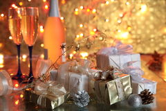 Gift boxes and champagne Stock Images