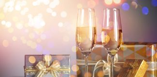 Gift boxes with champagne flutes. Against gray background Royalty Free Stock Image