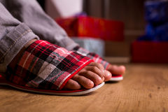 Gift boxes beside child's feet. Royalty Free Stock Photos